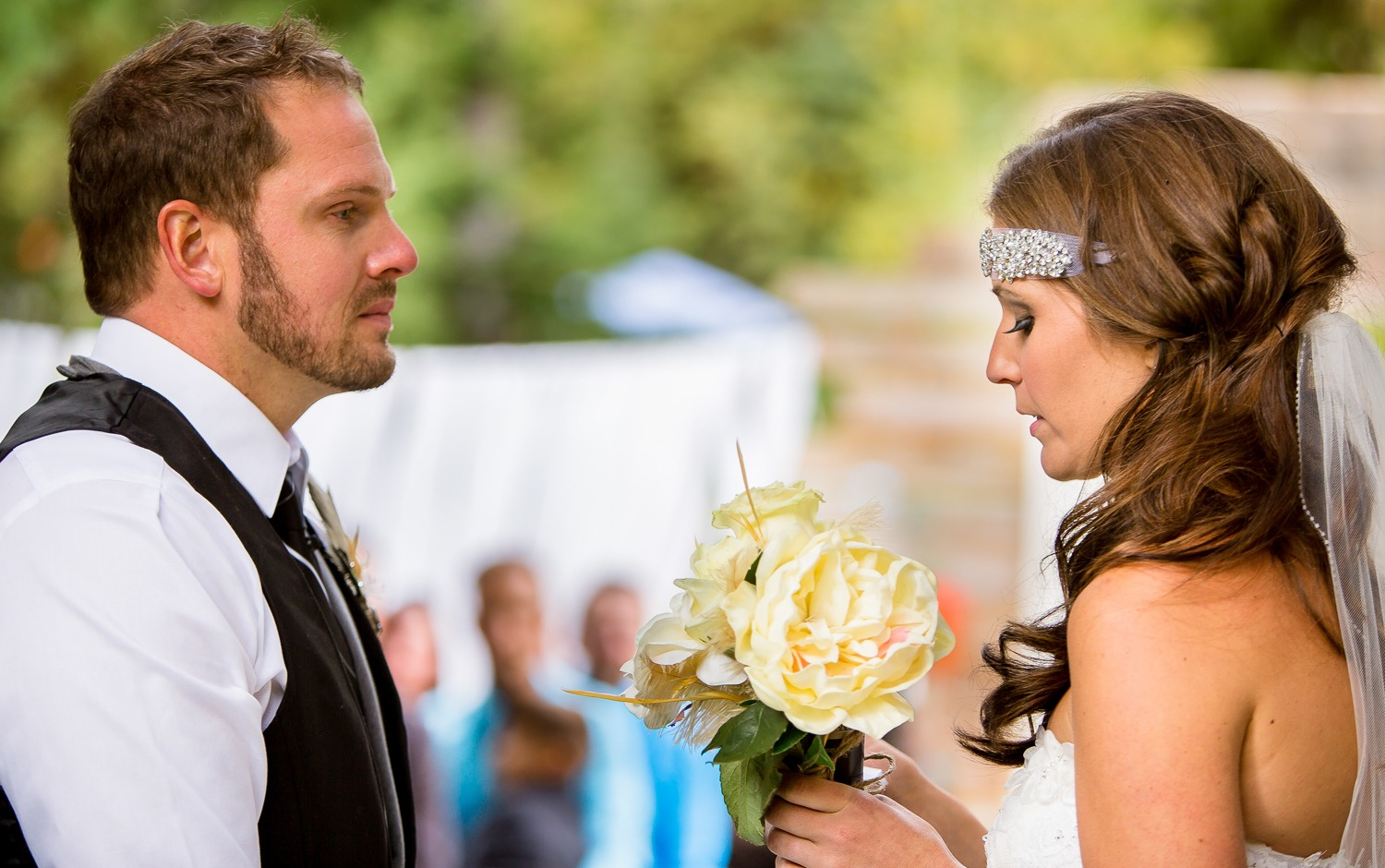 Bride and Groom Reciting Personal Wedding Vows They Wrote Themselves