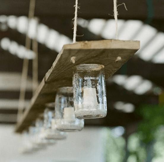7 DIY Mason jar Ikea chandelier using old 1x4, Ikea mason jars and candles. Hang with strong twine.