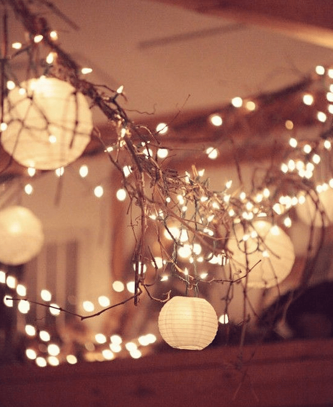 Garland made with grapevine, string lights and paper lanterns. Cute for indoors or out.