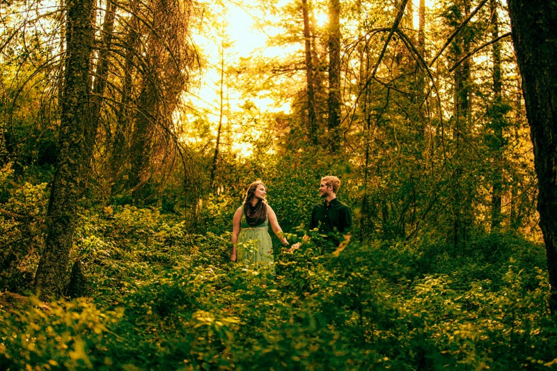 photo of couple holding hands in the forest at sunset in Kal Park near cousins bay.
