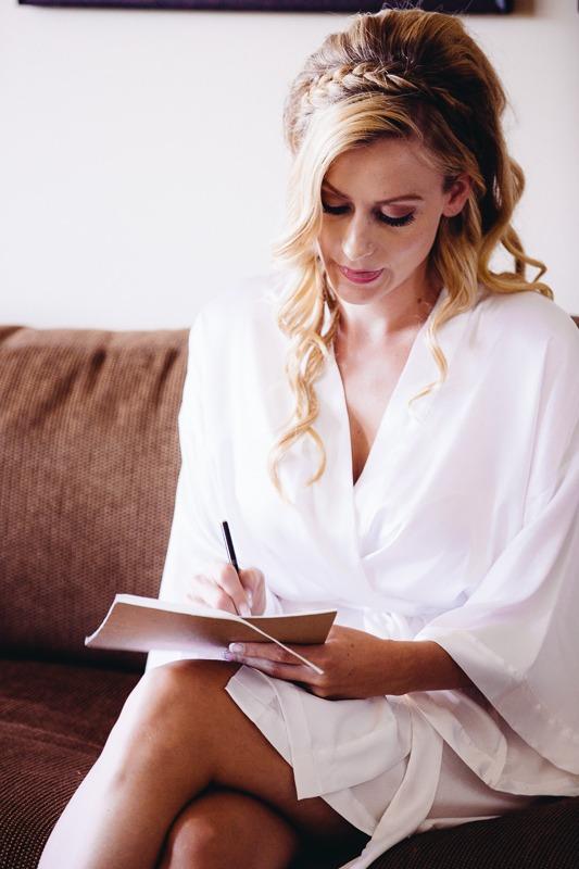 Bride writing her wedding vows