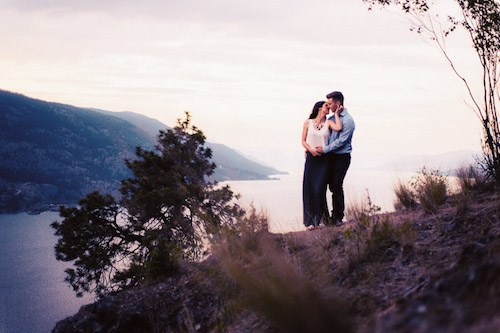 engagement photography overlooking okanagan lake at sunset by kelowna wedding photographer tailored fit photography at Knox Mountain Park Kelowna