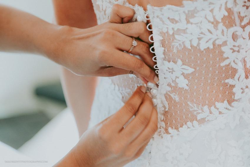 gorgeous wedding dress fabric buttoning up the dress
