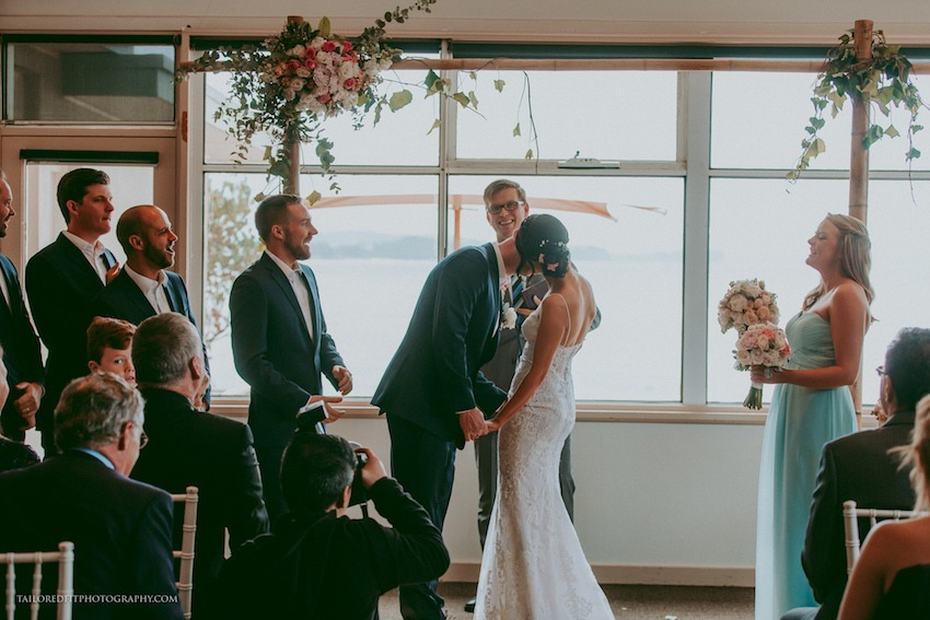 putting on the ring - long reef golf club wedding photos by australia wedding photographers tailored fit photography, hillsong wedding