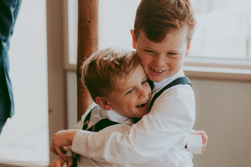ring bearers hugging - cutest flower girl ring bearer outfits