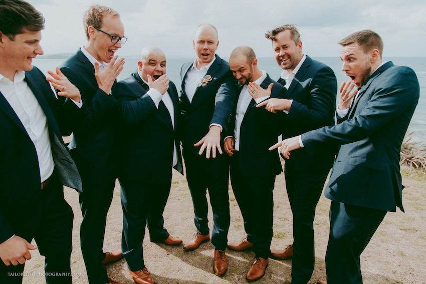 groom showing off ring to groomsmen hilarious wedding photography funny wedding photo ideas