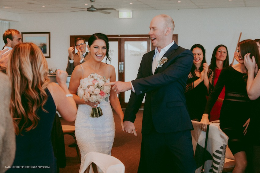 bride and groom enter reception photos reception entry at long reef golf club collaroy