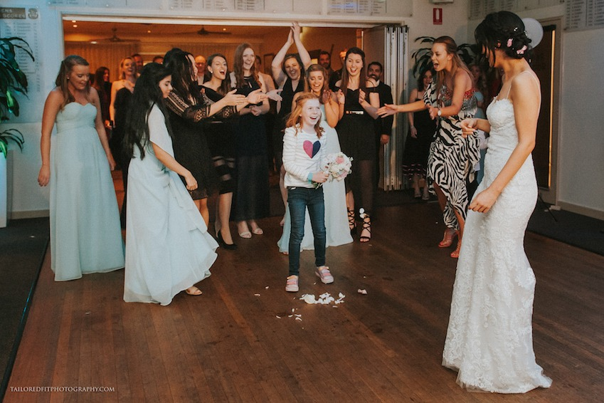 hilarious garter toss at beach wedding reception at long reef golf club collaroy