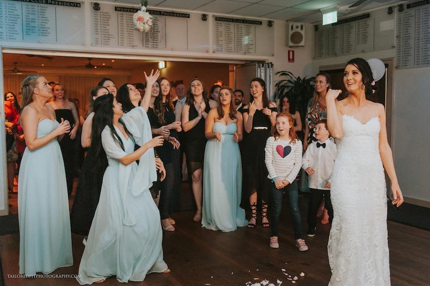 hilarious garter toss at beach wedding reception at long reef golf club collaroy