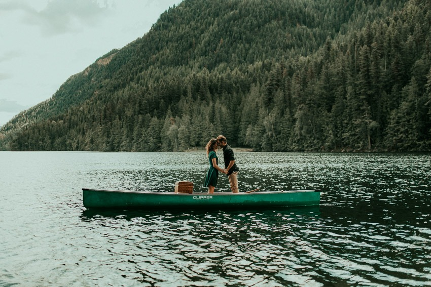 engagement photos standing in a canoe proposal engagement photography