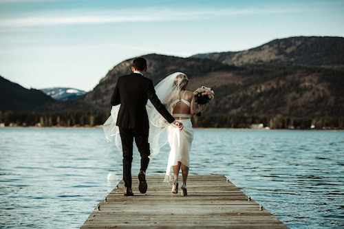 wedding photo of couple on dock at wedding in the shuswap british columbia canada by shuswap wedding photographer tailored fit photography