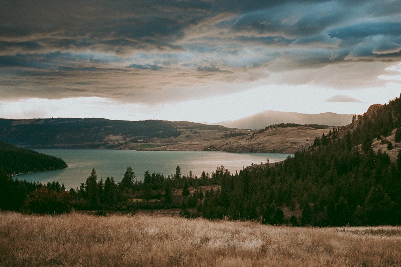 view of kalamalka lake from cousins bay in kal provincial park, coldstream, bc canada at sunset