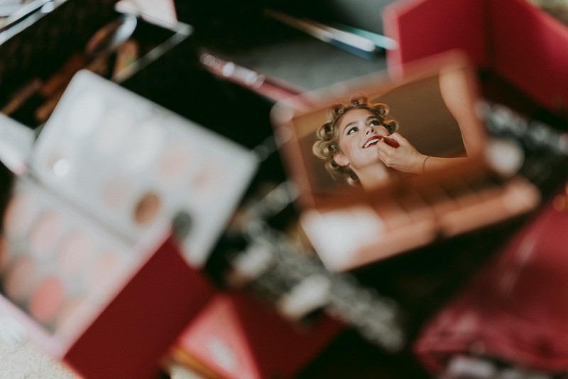 creative bridal prep photos - bride makeup reflection