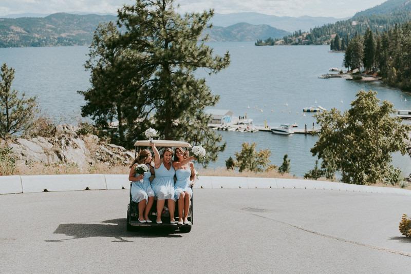 bridesmaids on golf cart photo - okanagan resort wedding ceremony outdoors in Kelowna BC Canada