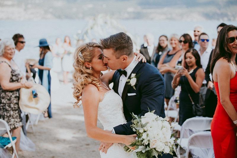 first kiss photos - okanagan resort wedding ceremony outdoors in Kelowna BC Canada