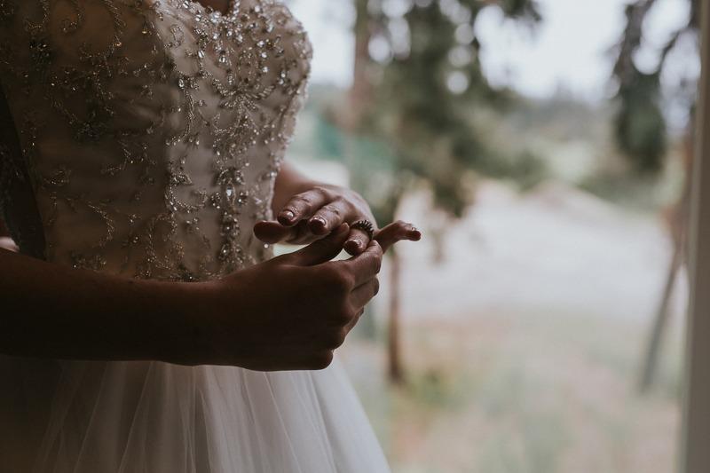 bride holding wedding ring, nervous bride just before wedding ceremony
