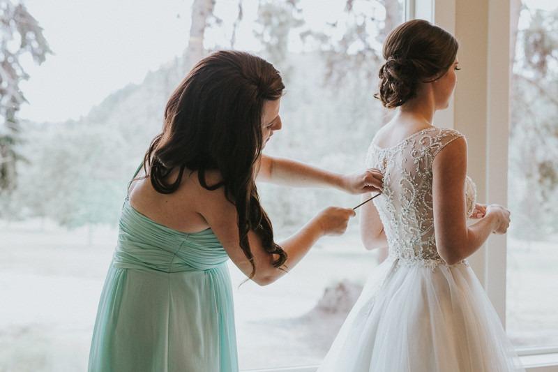 zipping up fairytale wedding dress photos