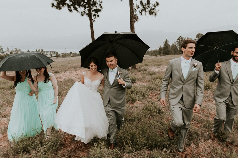 rainy day wedding - bridal party umbrellas - rainy wedding photos - wet wedding photo ideas