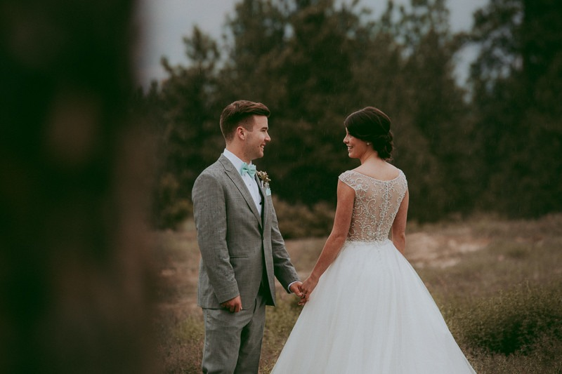 cute first look - amazing first look wedding photos - groom sees bride for first time - groom crying when he sees the bride