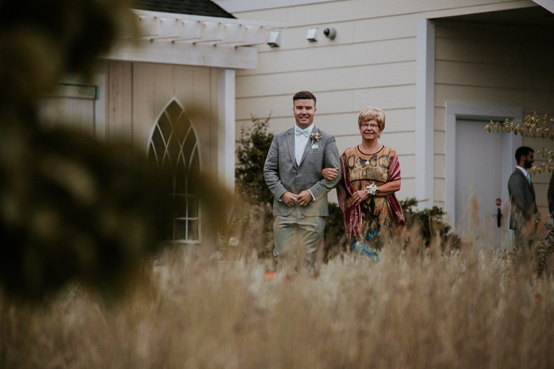 groom walking mom down the aisle - wedding ceremony at sanctuary gardens in west kelowna -