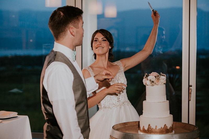 cutting the cake at wedding reception at tantalus winery - 1670 DeHart Rd, Kelowna, BC V1W 4N6