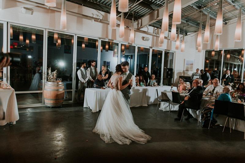 first dance at cutting the cake at wedding reception at tantalus winery - 1670 DeHart Rd, Kelowna, BC V1W 4N6