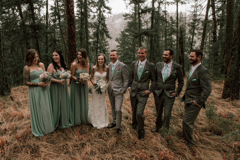 wedding party photos that aren't cheesy - rainy wedding - amazing forest photoshoot - forest wedding in the woods and trees