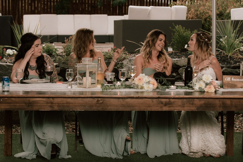 bridesmaids laughing at head table - durali villa wedding reception in vernon bc outdoors details