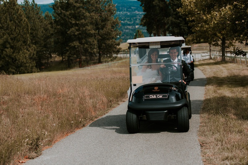 outdoor wedding venue kelowna - okanagan golf club in the golf carts for wedding photoshoot