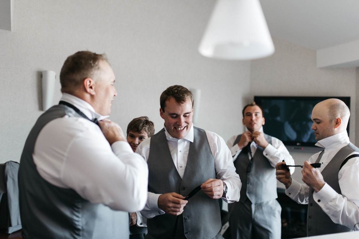 groom preps morning at tru wedding