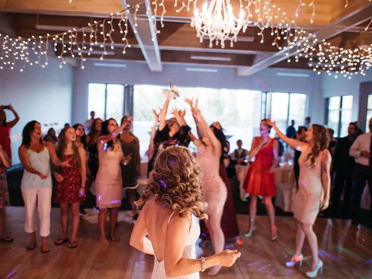 garter toss dance floor at tru wedding reception at thompson river university